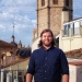 Christian Setzer, PhD student in Observational Cosmology at Stockholm University, at a conference in Valencia, Spain. In the background is the impressive cathedral tower as could be seen from the top of the conference venue.